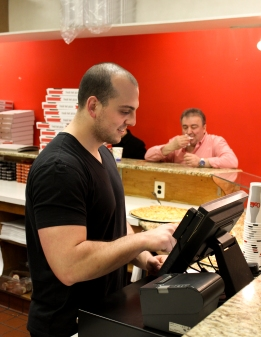 Plaza employee Sam Memmos is one of many Greeks that works in the pizza business on Temple's Main Campus. (Photo: Tom Reifsnyder)